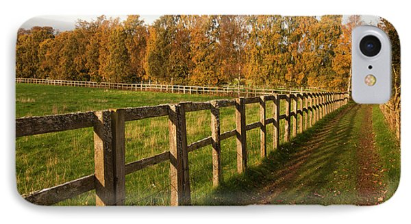 Tire Tracks Along A Fence In A Rural IPhone Case by John Short