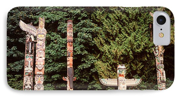 Totem Poles In A Park, Stanley Park IPhone Case by Panoramic Images