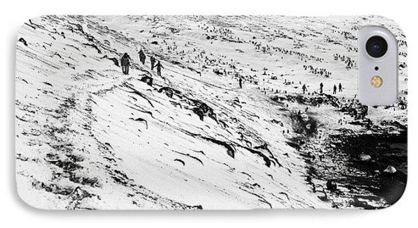 tourists walking along ridge at hannah point penguin colony Antarctica IPhone Case