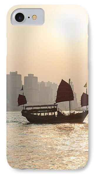 Traditional Junk Boat Sailing In Hong Kong Harbor IPhone Case by Matteo Colombo