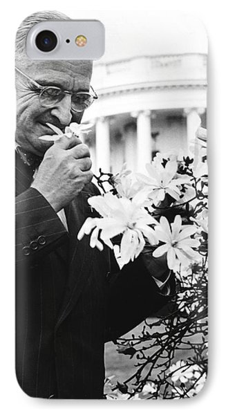 Truman Smells A Flower IPhone Case by Underwood Archives