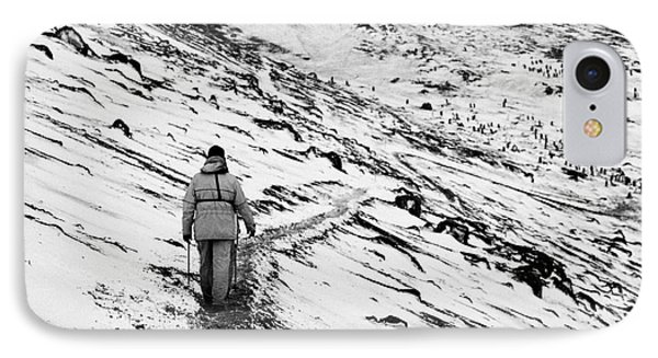 two tourists walking along ridge at hannah point penguin colony Antarctica IPhone Case