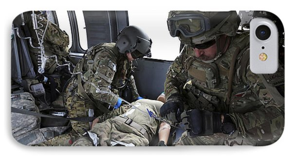U.s. Army Flight Medics Aid A Simulated Phone Case by Stocktrek Images