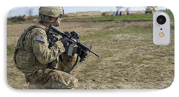 U.s. Soldier Patrols A Village IPhone Case by Stocktrek Images