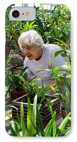 Volunteer At A Botanic Garden IPhone Case by Jim West