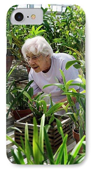 University Of Michigan iPhone 7 Case - Volunteer At A Botanic Garden by Jim West
