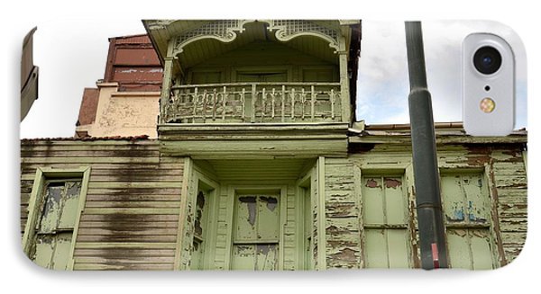 IPhone Case featuring the photograph Weathered Old Green Wooden House by Imran Ahmed