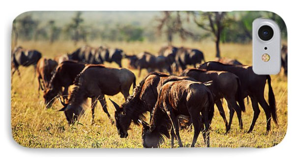 Wildebeests Herd. Gnu On African Savanna Phone Case by Michal Bednarek