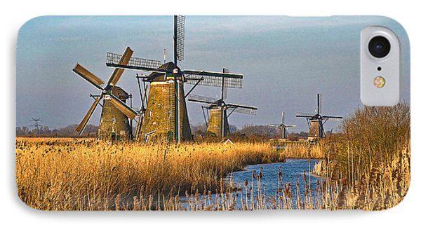 IPhone Case featuring the photograph Windmills And Reeds Near Kinderdijk by Frans Blok