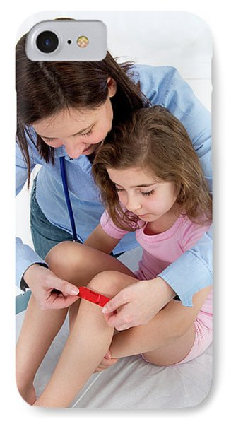 Woman Applying Plaster To Girl's Knee IPhone Case