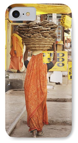Woman Carrying Cow Dung In Basket On Phone Case by Paul Miles
