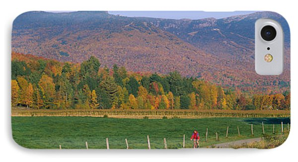 Woman Cycling On A Road, Stowe IPhone Case by Panoramic Images