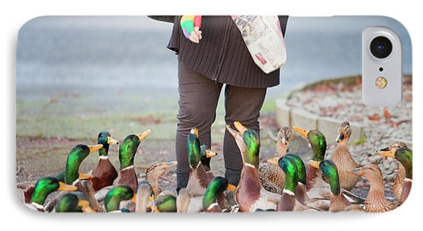 Woman Feeding Mallard Ducks IPhone Case by Ashley Cooper