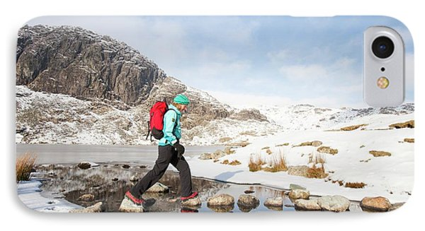 Woman Walker And Frozen Stickle Tarn IPhone Case by Ashley Cooper