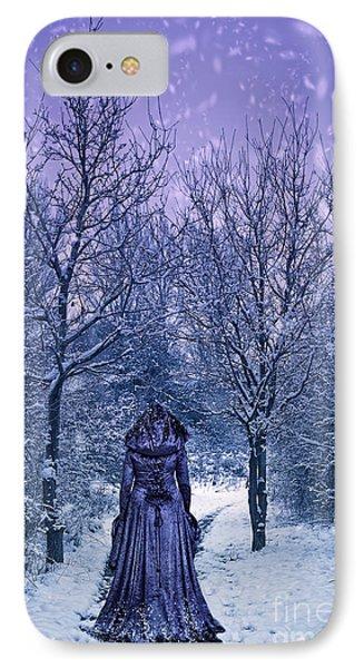 Woman Walking In Snow Phone Case by Amanda Elwell