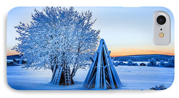 Wood Stacked And A Snow Covered Tree IPhone Case
