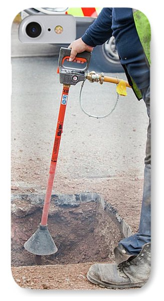 Worker Using A Compressed Air Soil Picker IPhone Case by Ashley Cooper