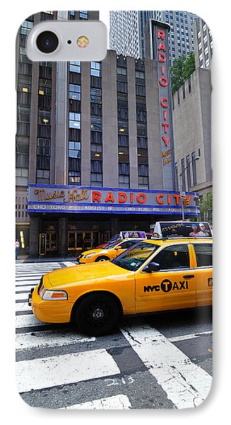 Yellow Cabs Pass In Front Of Radio City Music Hall Phone Case by Amy Cicconi