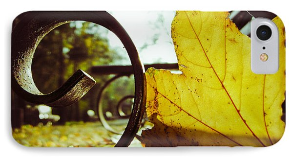 Yellow Leaf On A Bench In A Park IPhone Case