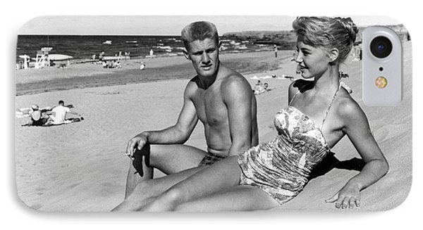 Young Adults On A Beach IPhone Case by Underwood Archives