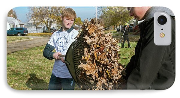 Young Volunteers Raking Leaves IPhone Case by Jim West