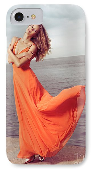 Young Woman In Orange Dress Flying In The Wind At Sea Shore Phone Case by Oleksiy Maksymenko