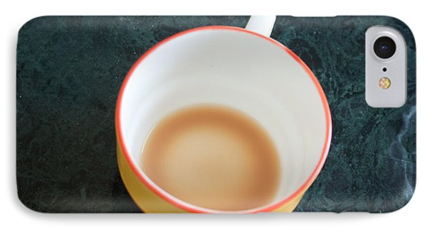 A Cup With The Remains Of Tea On A Green Table IPhone Case by Ashish Agarwal
