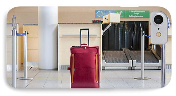 Luggage At An Airline Check-in Counter IPhone Case by Jaak Nilson