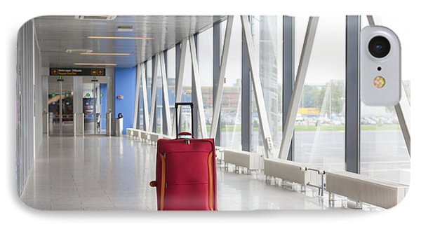 Rolling Luggage In An Airport Concourse Phone Case by Jaak Nilson