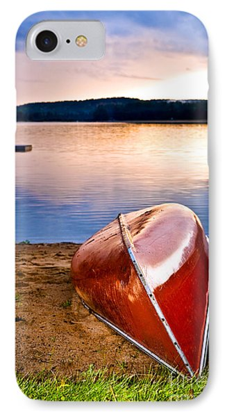 Lake Sunset With Canoe On Beach Phone Case by Elena Elisseeva