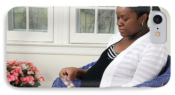 Pregnant Woman Taking Vitamins IPhone Case by Photo Researchers
