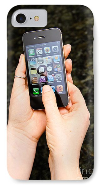 Hands Holding An Iphone Phone Case by Photo Researchers, Inc.