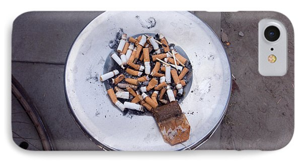 A Lot Of Cigarettes Stubbed Out At A Garbage Bin IPhone Case by Ashish Agarwal