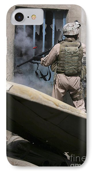 A Military Policeman Uses A Breaching Phone Case by Stocktrek Images