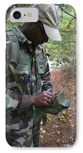 A Military Technician Uses A Pda Phone Case by Michael Wood