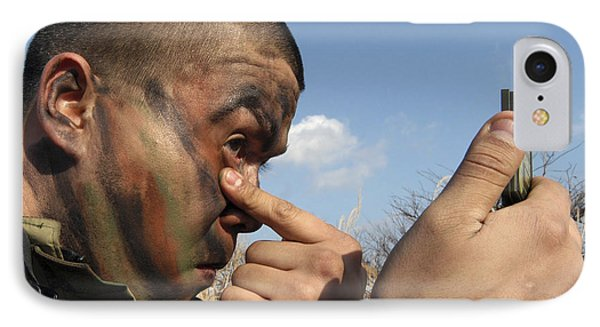 A Soldier Applying Face Paint Prior Phone Case by Stocktrek Images