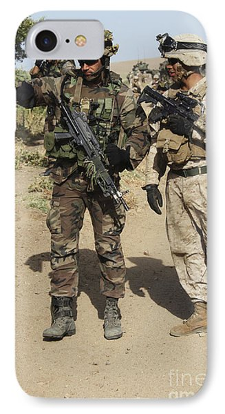 A Spanish Marine Points Out An Phone Case by Stocktrek Images