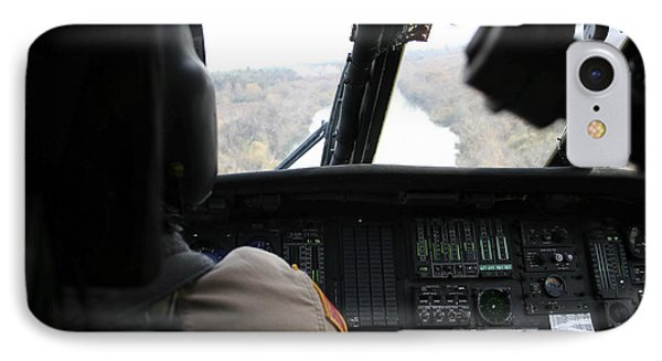 A Uh-60 Blackhawk Flies The River To An Phone Case by Terry Moore