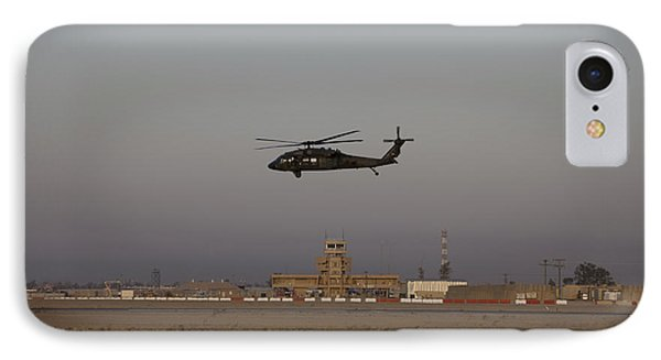 A Uh-60 Blackhawk Helicopter Flies Phone Case by Terry Moore
