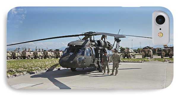 A Uh-60l Blackhawk Parked On Its Pad Phone Case by Terry Moore