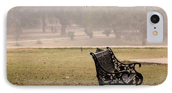 A Wrought Iron Black Metal Bench Under A Tree In The Qutub Minar Compound IPhone Case by Ashish Agarwal