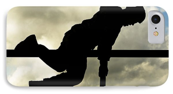An Airman Scales An Obstacle At Camp IPhone Case by Stocktrek Images