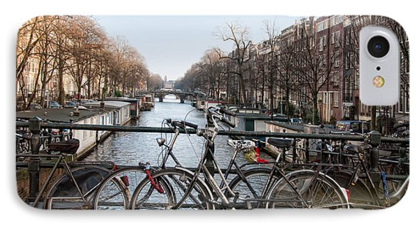 IPhone Case featuring the digital art Bikes On The Canal In Amsterdam by Carol Ailles