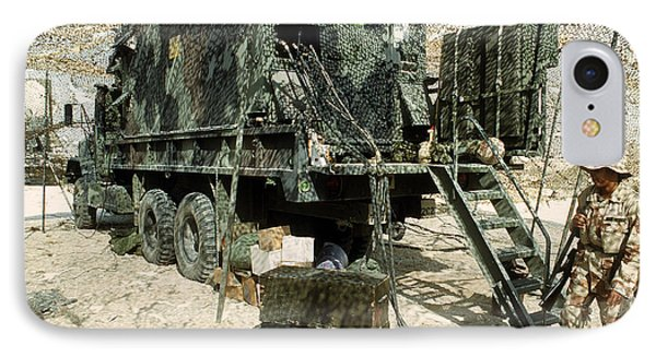 Camouflage Netting Covers A Cargo Truck Phone Case by Stocktrek Images