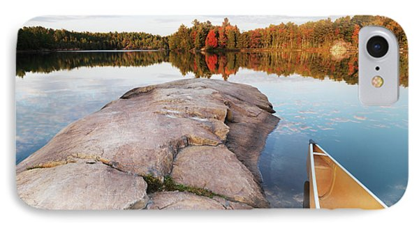 Canoe At A Rocky Shore Autumn Nature Scenery Phone Case by Oleksiy Maksymenko