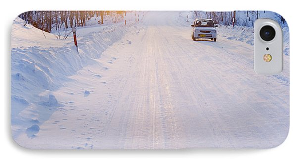Car On Snow Covered Road Phone Case by Jeremy Woodhouse