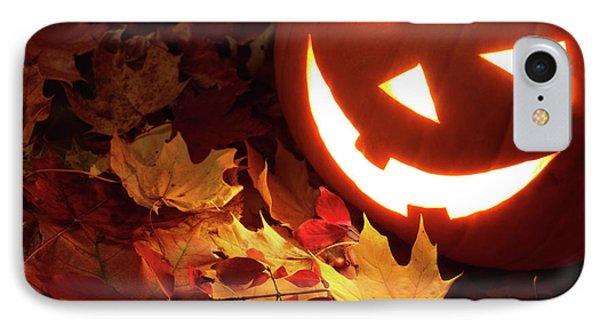 Carved Pumpkin On Fallen Leaves IPhone Case by Oleksiy Maksymenko