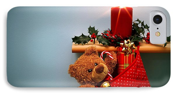 Christmas Stocking Filled With Presents With Candle And Holly. IPhone Case by Richard Thomas