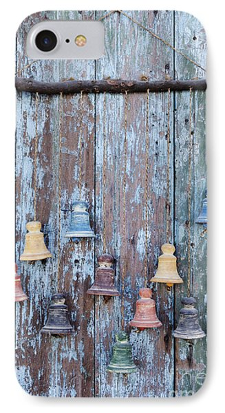 Clay Bells On A Weathered Door Phone Case by Jeremy Woodhouse