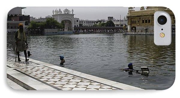 Clearing The Sarovar Inside The Golden Temple Resorvoir IPhone Case by Ashish Agarwal